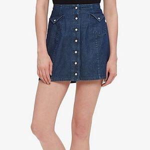 Denim skirt with white buttons